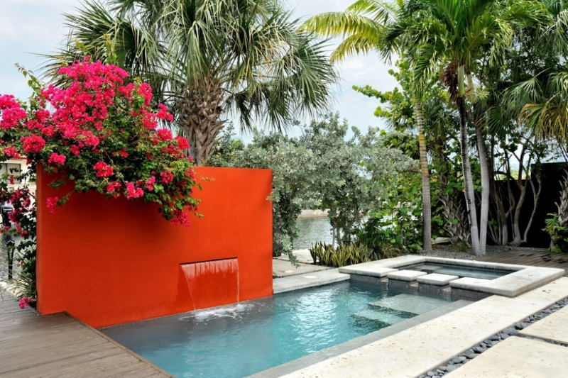 Red orange wall in a modern outdoor space Survive the Winter by Dreaming of Spring Outdoor Projects!