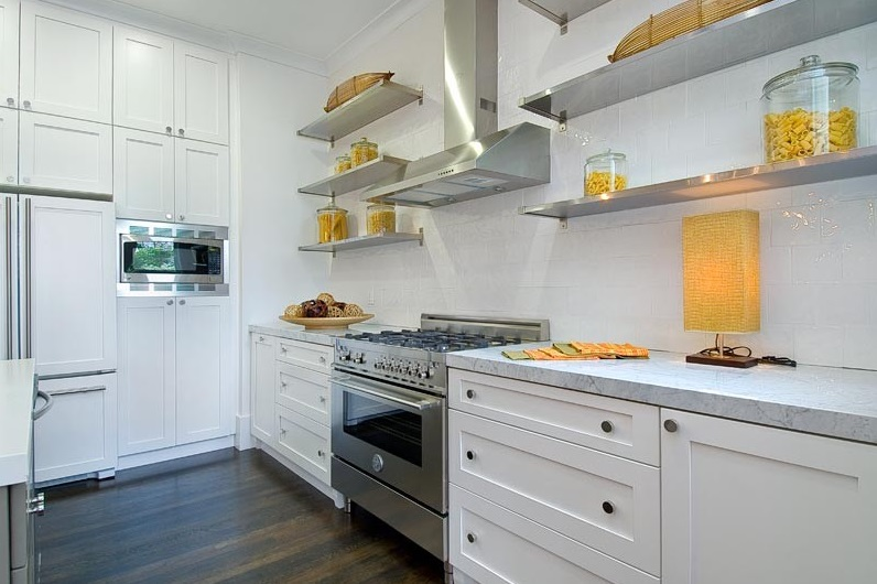 Shades of yellow on open stainless steel kitchen shelving