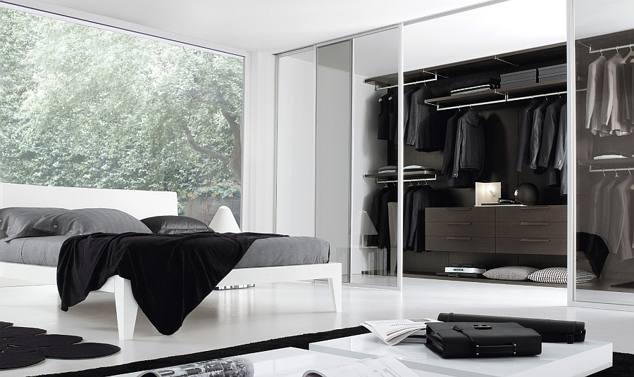 View in gallery Sleek and stylish bedroom in black and white with a walk-in closet & 12 Walk-In Closet Inspirations To Give Your Bedroom A Trendy Makeover