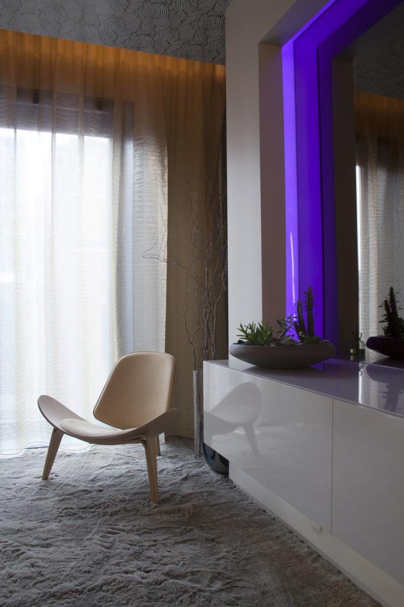 Sleek bedroom with modern lighting