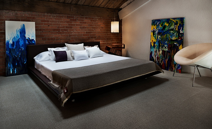 Smart industrial style bedroom with a slanting roof [Photography: Vantage Imagery]