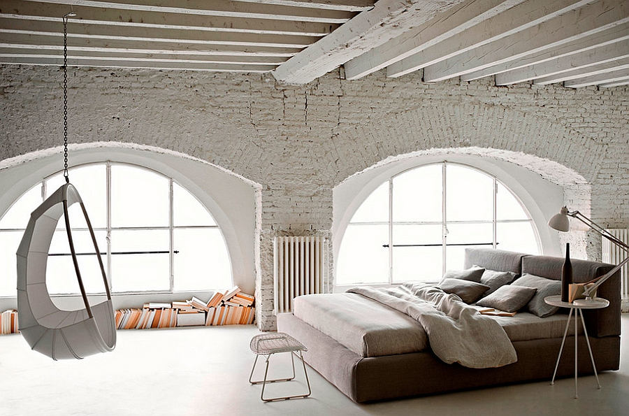 Spacious bedroom with white brick walls and unique decor [Design: usona]