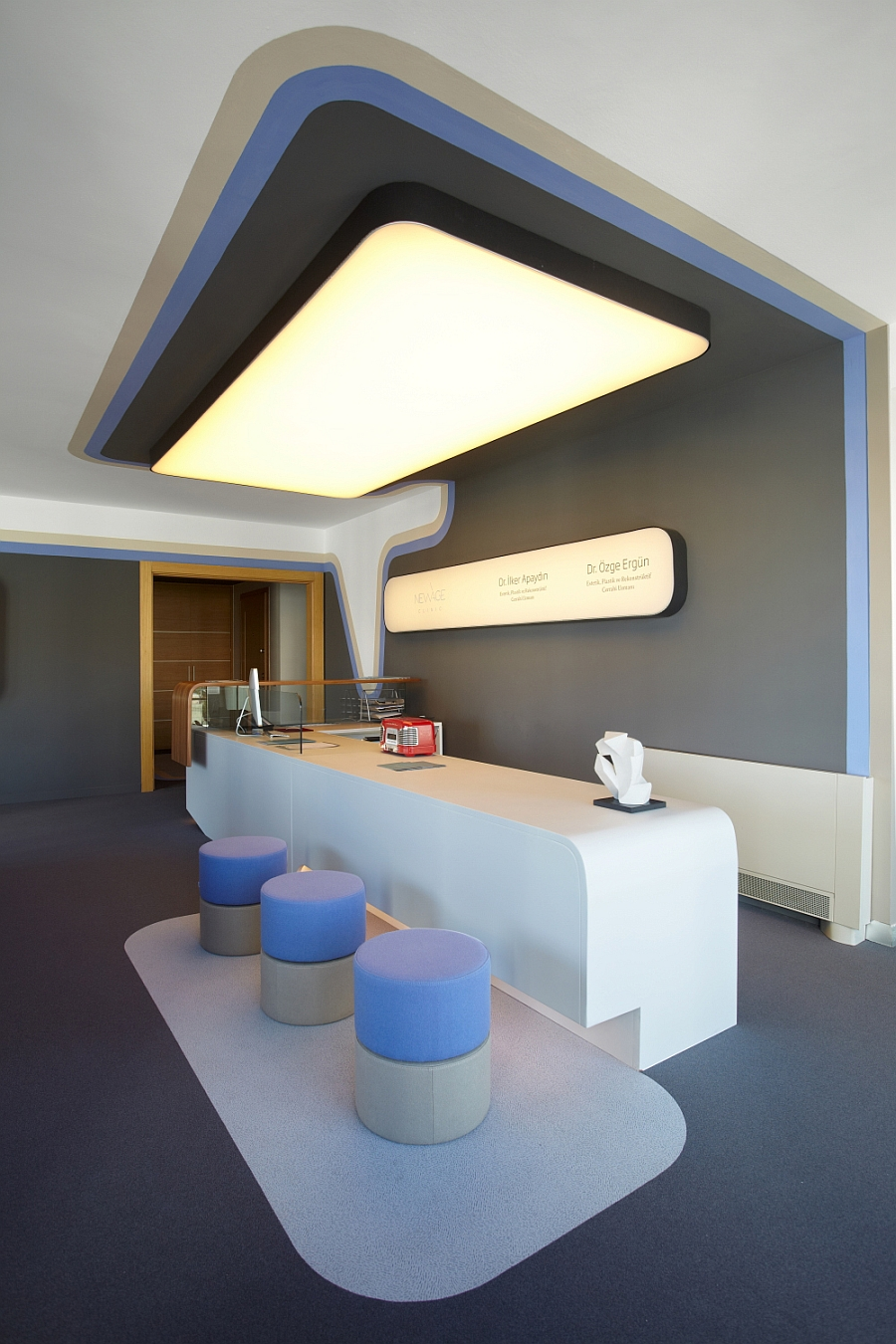 Specially crafted reception desk welcomes the clientele at the clinic