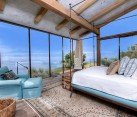 Stunning Mediterranean style bedroom with a breathtaking view! [Design: Decker Bullock Sotheby's International Realty]
