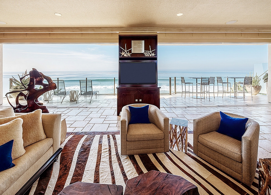 Stunning ocean view from the living room with coastal and tropical styles