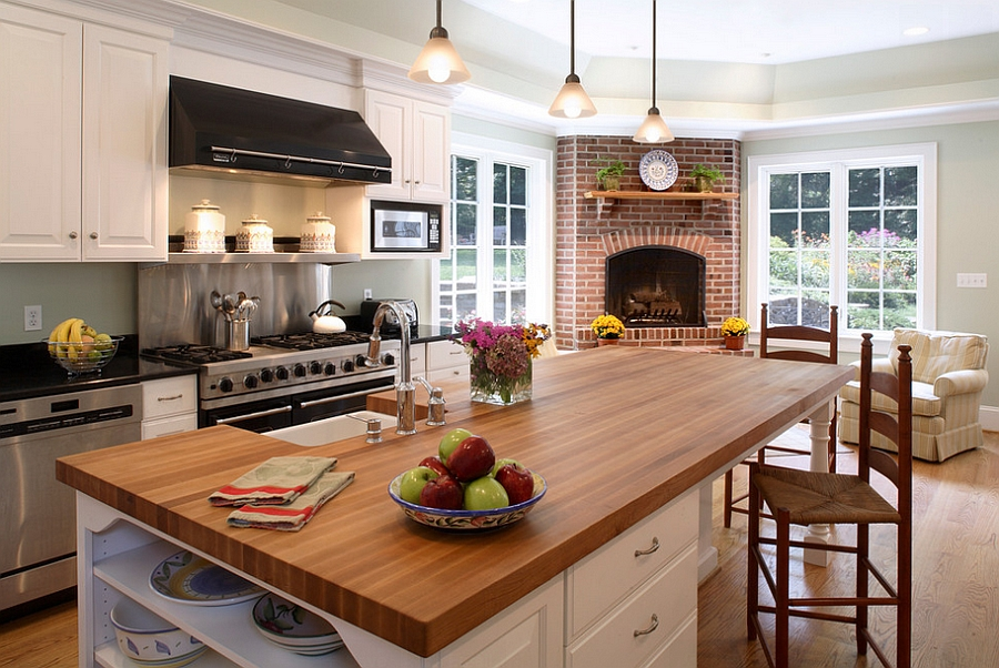 Traditional kitchen with a beautiful corner fireplace [Design: Owings Brothers Contracting]