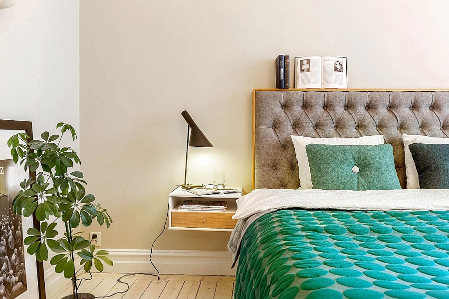 Unique floating bedside table and tufted headboard steal the show