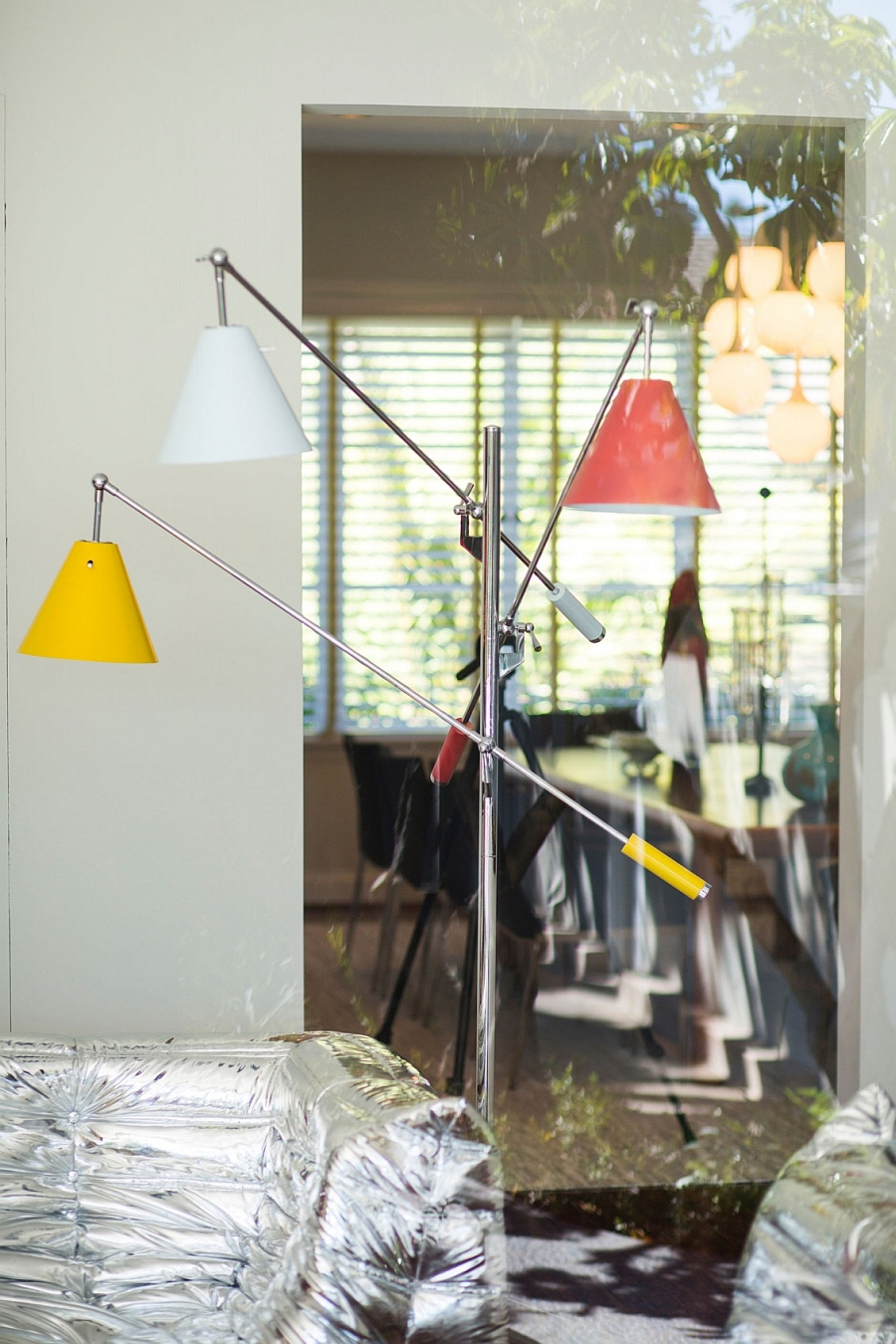 Versatile floor lamp with adjustable lamps makes for a practical and colorful addition