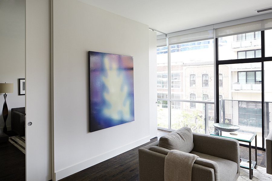 Versatile sliding doors help shape dynamic interiors inside the Chicago condominium
