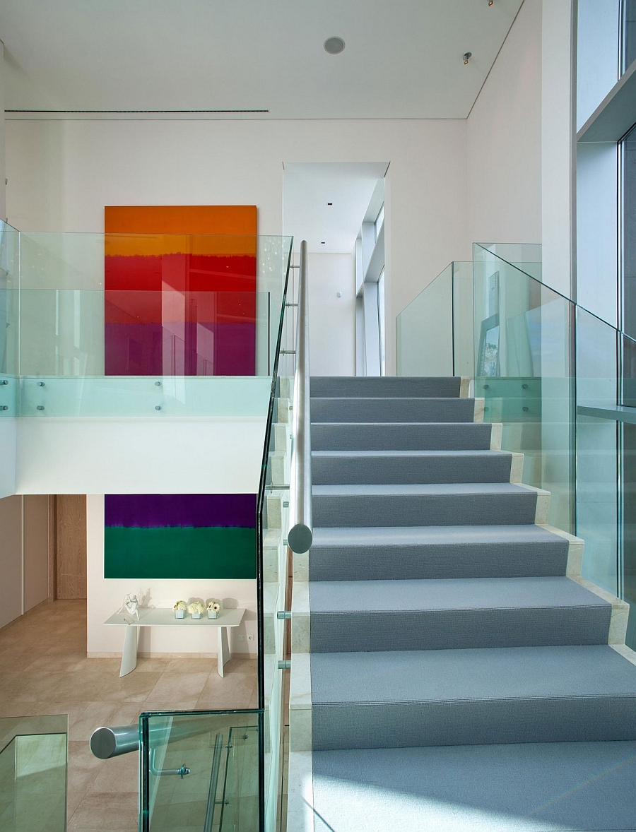 Vibrant art additions add color to the modern interior