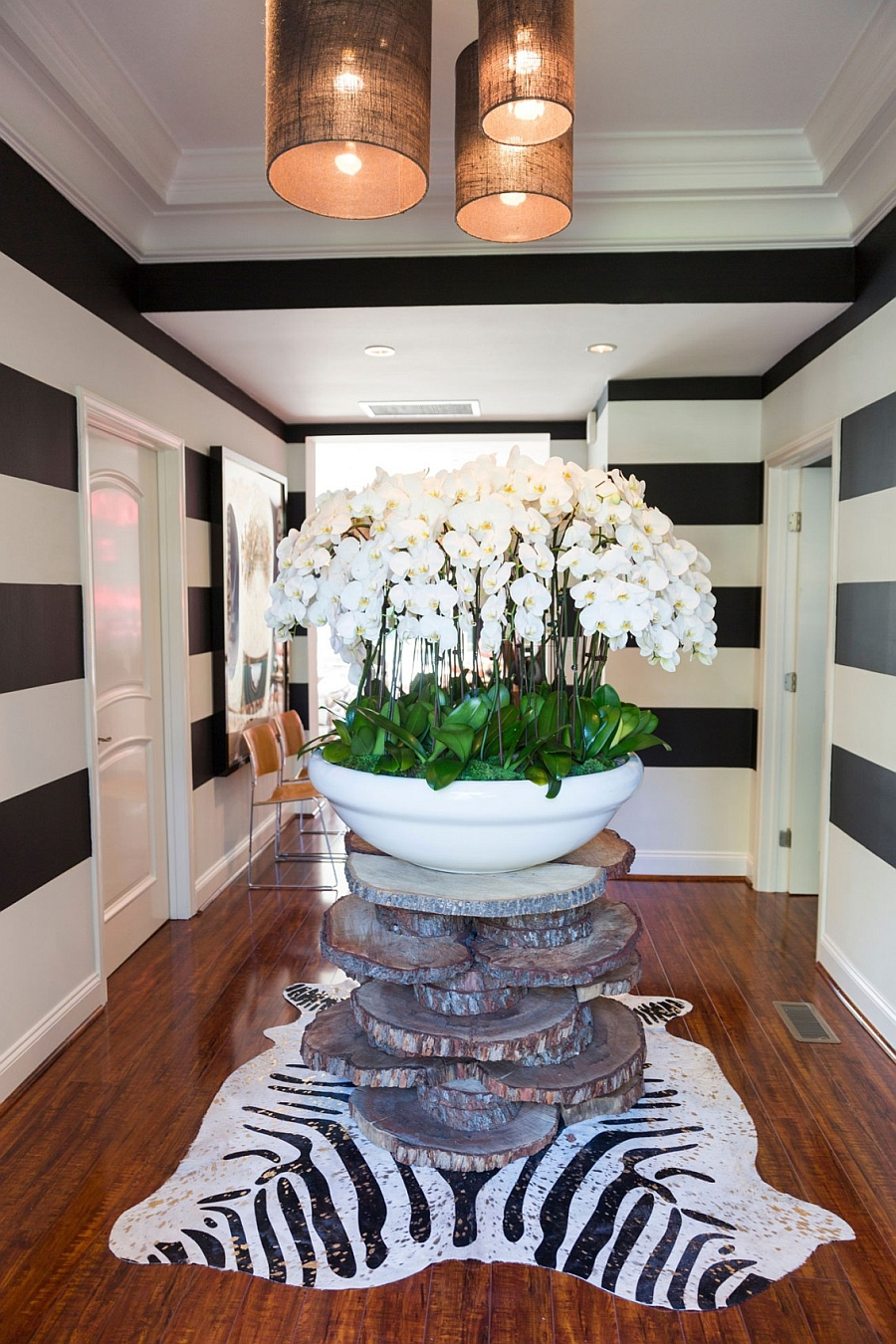 Vintage entrance with a giant vase and black and white stripes
