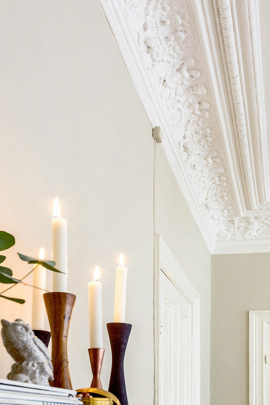 Wall ceiling and candles add sense of timeless style to the room