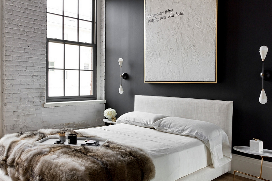 White brick and dark accent wall add contrast to the NYC apartment bedroom [Design: Tamara Magel Studio]