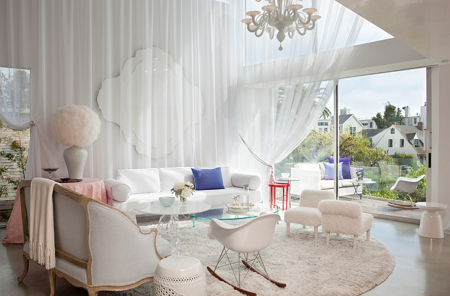 View in gallery White drapes and cozy decor give the spacious room a  trendy, feminine look [Design