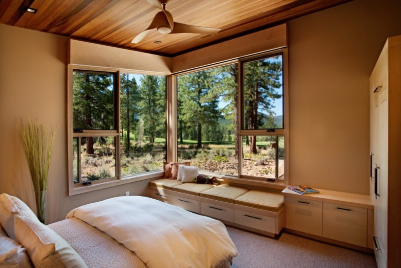 Window seat in an earthy bedroom