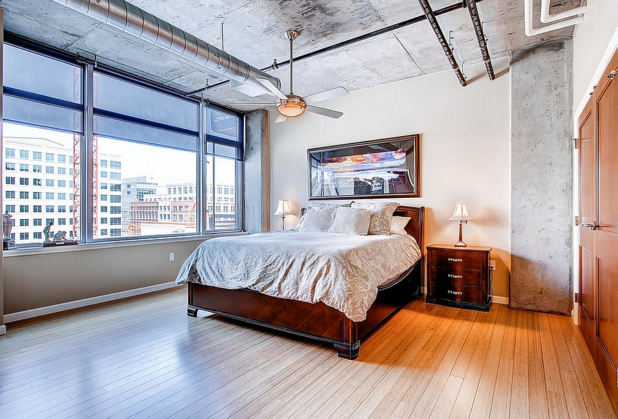 Wood, concrete and metal meet in this industrial style bedroom [Design: PorchLight Real Estate Group]