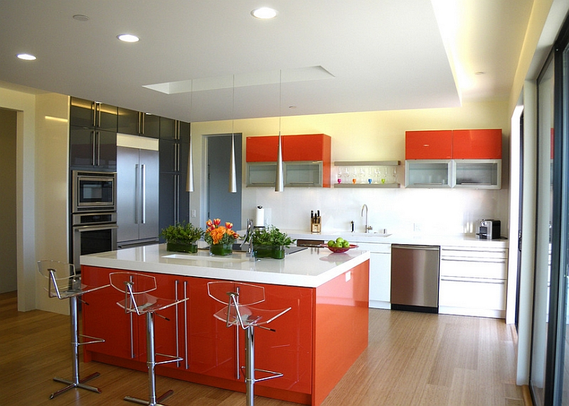 A touch of bright tangerine and black in the kitchen [Design: Mark English Architects]