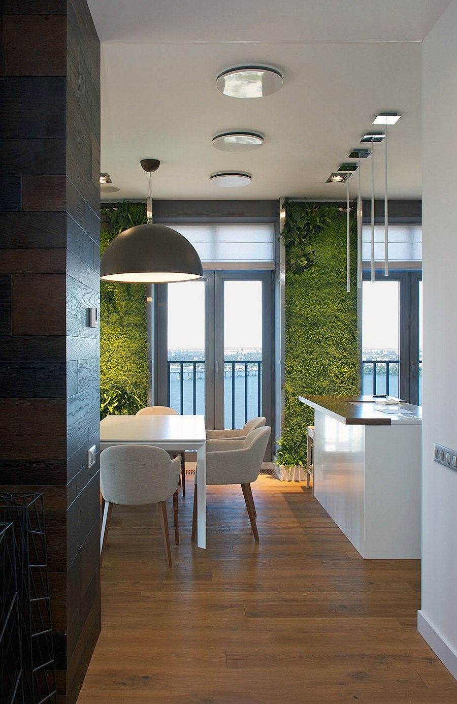 Accent lighting lits up the vetical wall gardens in the living room