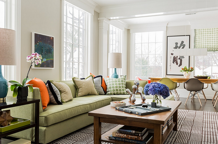 Add a subtle touch of black and orange with throw pillows [By: Terrat Elms Interior Design]