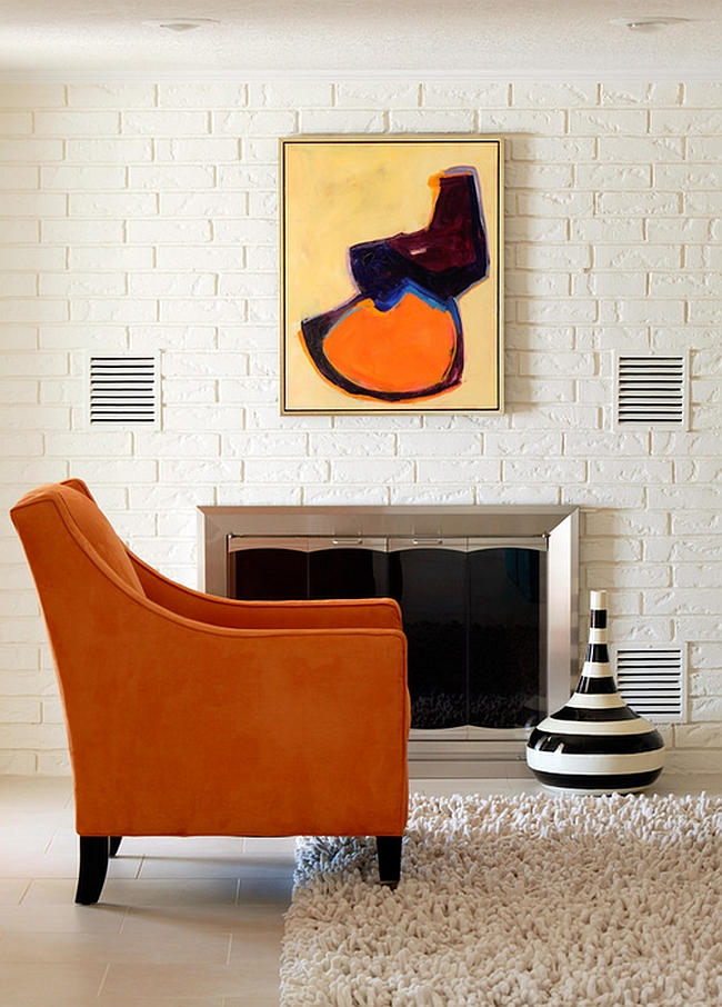 Art piece accentuates the color scheme of the room [By: Tobi Fairley Interior Design]