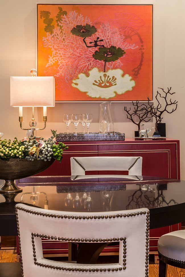 Art work adds bright orange to the dining room