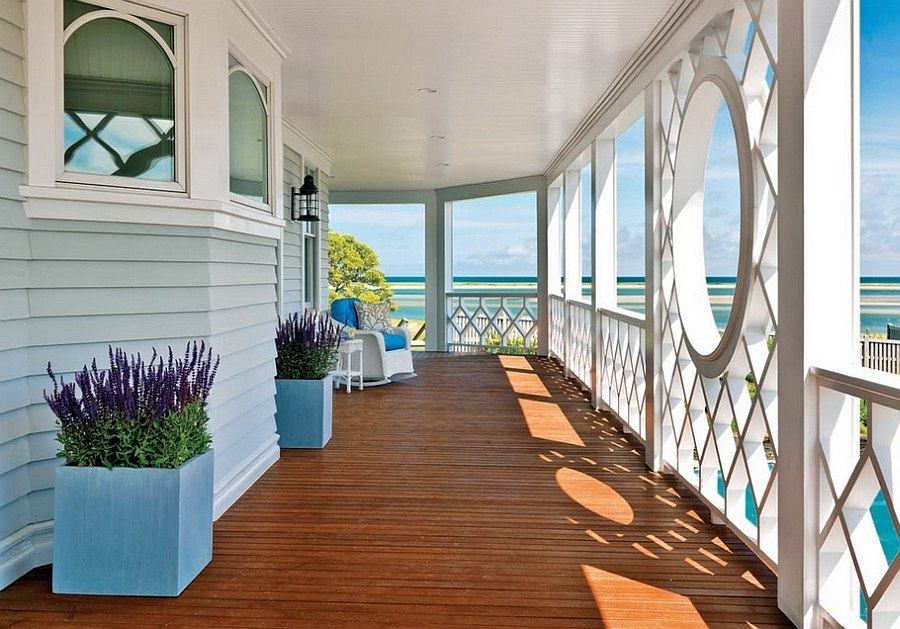 Beach style blue and white porch brings home summer charm [Design: Kotzen Interiors]