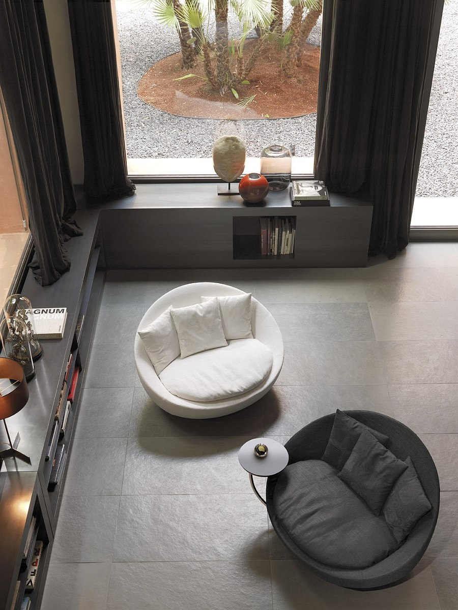 View in gallery beautiful armchairs add lovely curves to the contemporary setting