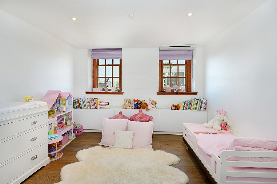 Beautiful kids' bedroom in white and pink