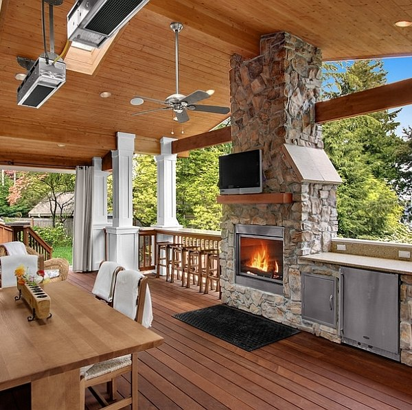 Stone Fireplace Next To The Outdoor Kitchen And A Lovely