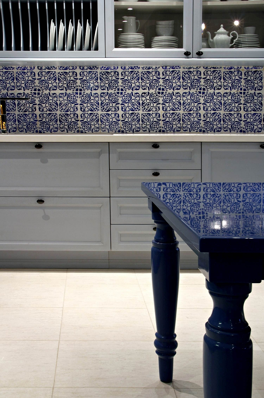 Beautiful shelves, wall tiles and table give the setting a classic appeal