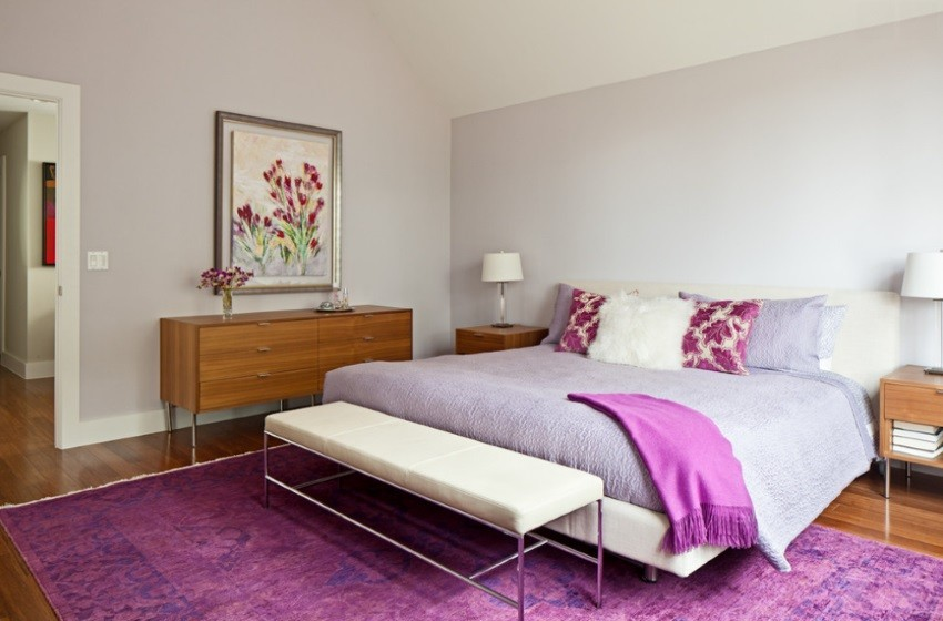Bedroom with an over-dyed rug in shades of purple