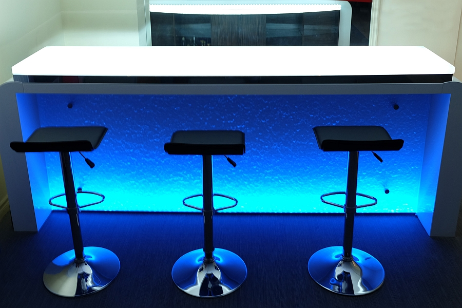 Blue LED lighting illuminates the stylish glass bar