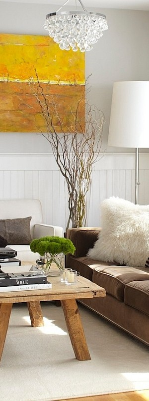 Branches in the glass vase add to the chic rustic style [Design: Urrutia Design]