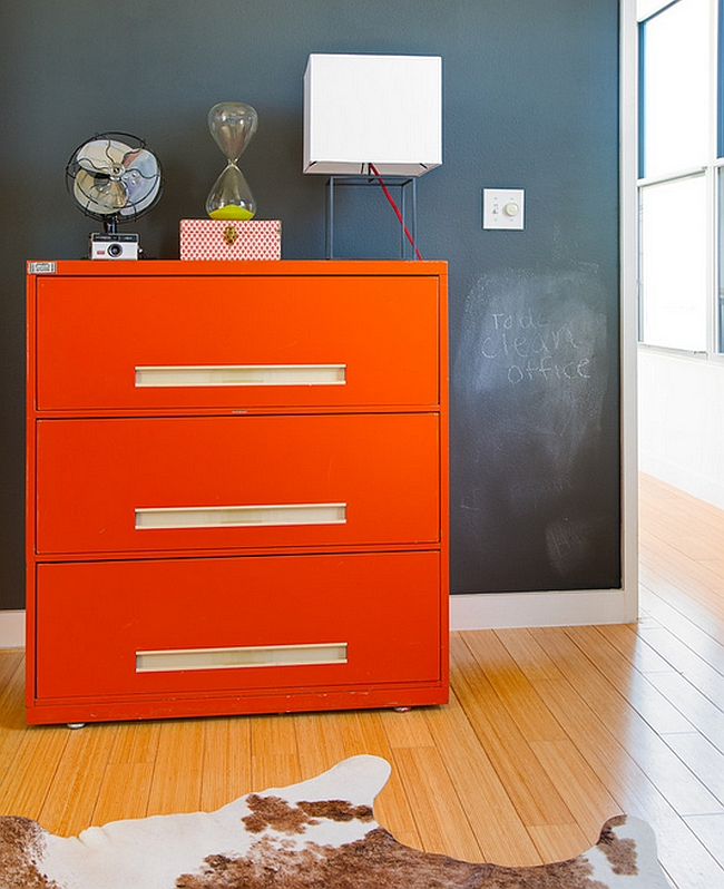 Bright orange cabinet stands out visually in any space it adorns [From: Kailey J. Flynn Photography]