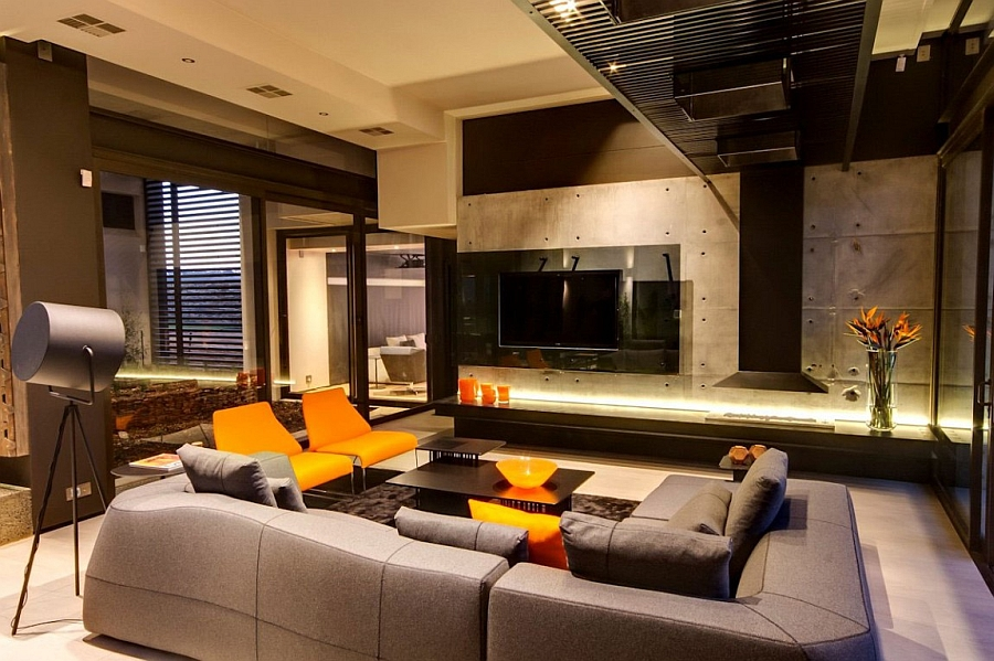 Bright pops of orange in the living room