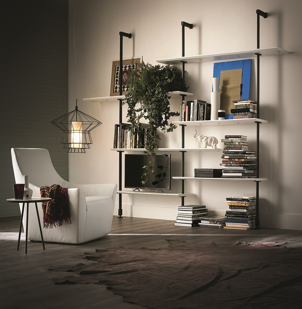 Canaletto walnut shelves and steel frame shape the stylish wall units