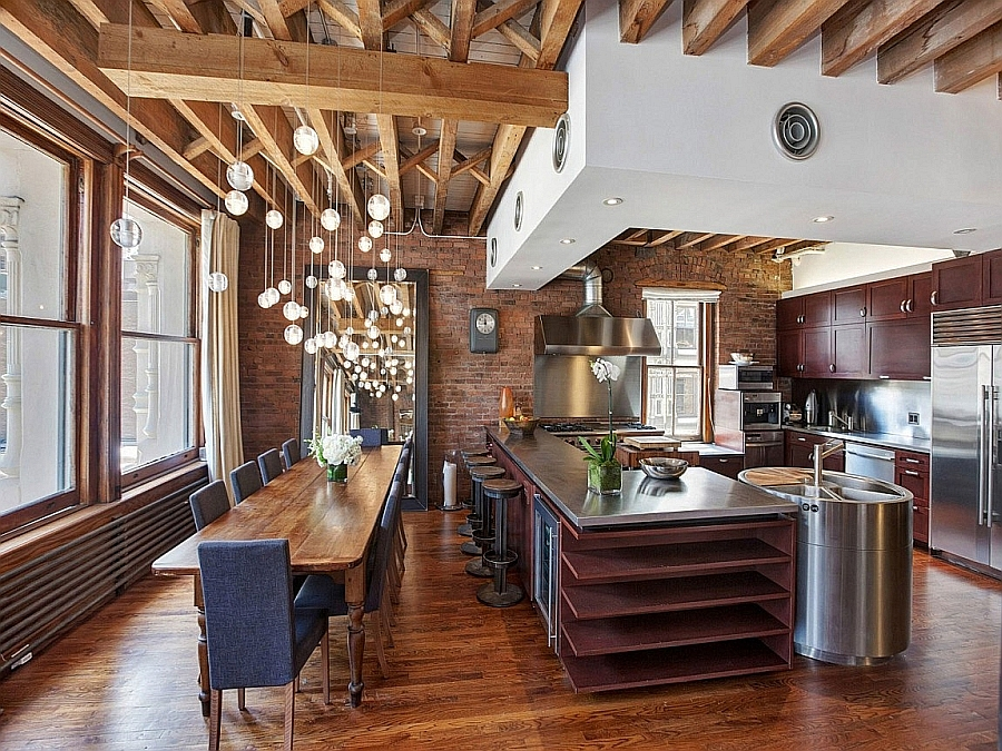 Cascading chandelier steals the show in this dining space