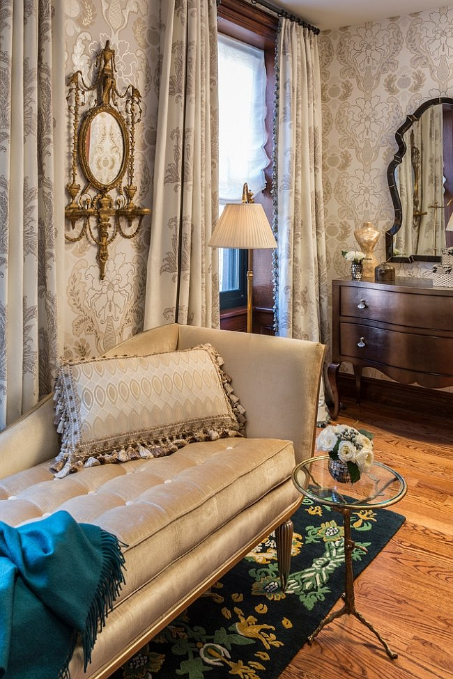 Chaise lounge and plush decor give the bedroom a luxurious appeal