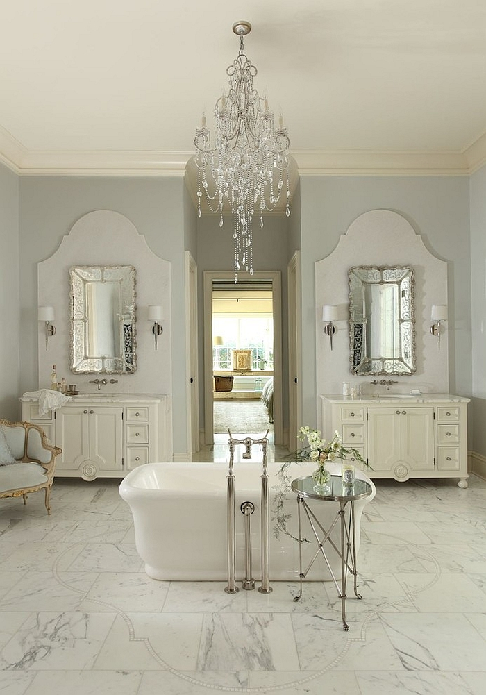 Classic chandeliers seem right at home in the feminine bathroom [Design: The Iron Gate]