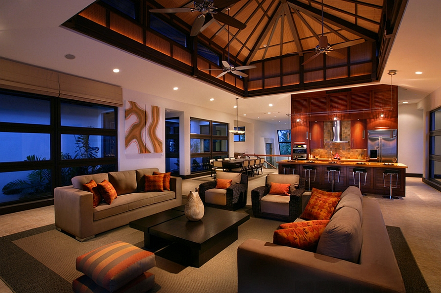 Classy use of orange and black in the tropical living room [Design: K2 Design Group]