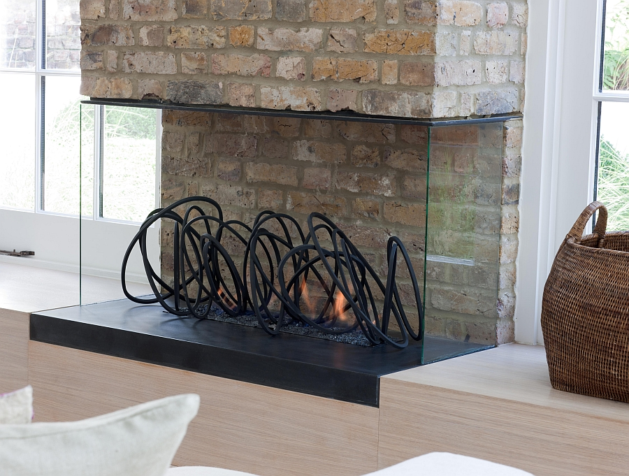 Closer look at the lovely steel sculptural loops inside the fireplace