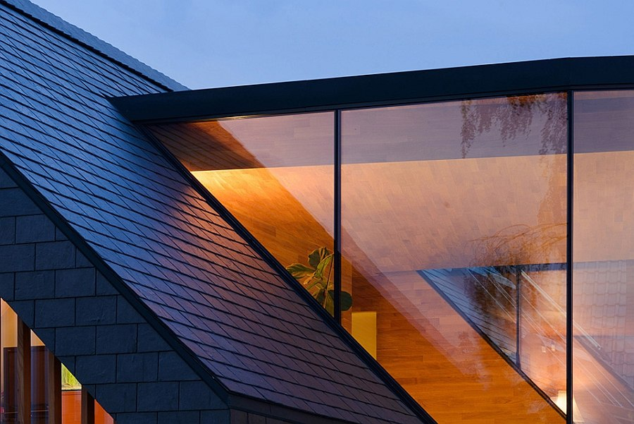 Contemporary glass facade combined with the classic sloped roof