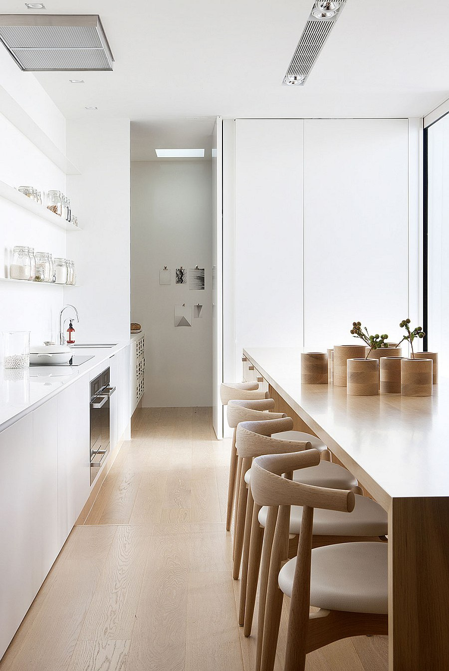 Contemporary kitchen with smart wooden kitchen island at its heart
