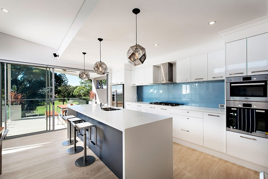 Cool blue backsplash and white kitchen cabinets borrow from the classic coastal colors Scenic Ocean Views And A Luminous Modern Vibe Shape Stylish Perth Home