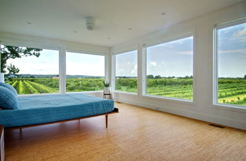 Cork flooring in a bedroom with a vineyard view