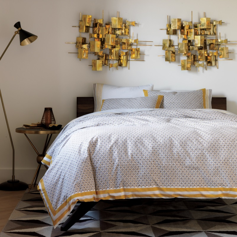 Cozy bedding with ochre accents