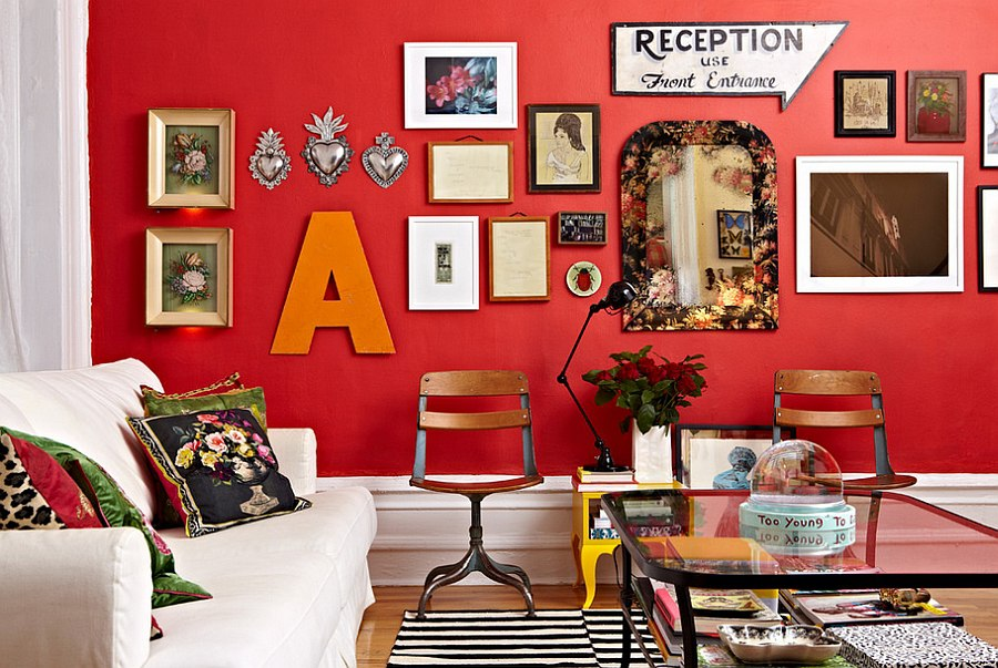 Create an eclectic gallery wall with red backdrop