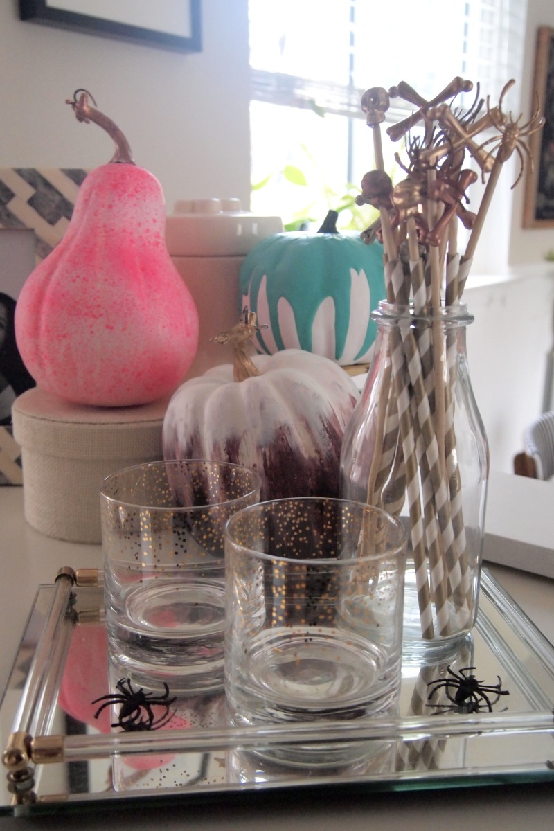 DIY stir sticks coupled with the painted pumpkins