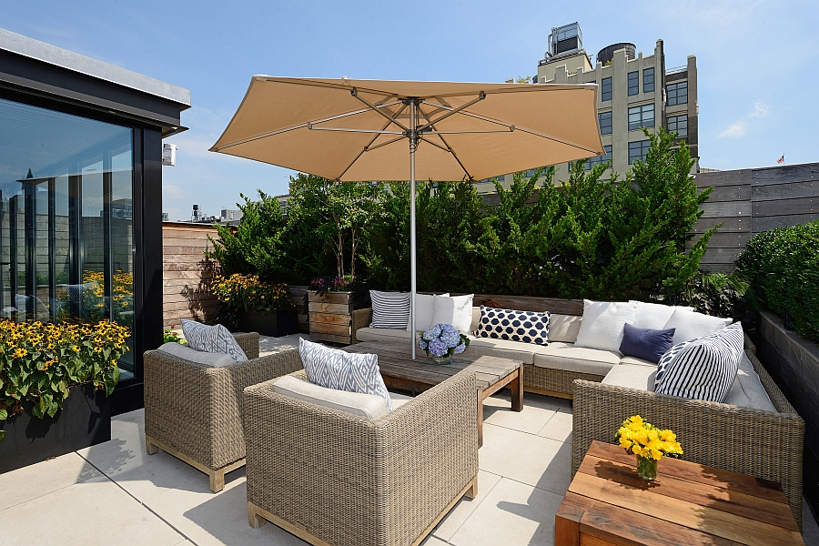 Dashing outdoor lounge area with view of the NYC skyline