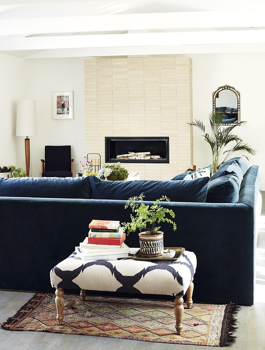Deluxe sofa in a living room with a modern fireplace